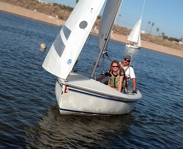 As you become more confident in your sailing, you'll handle the boat with just one other student. Photo: Rob Gibbs