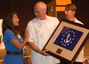Christina Campo and Tony Chapman congratulate Emory Heisler.