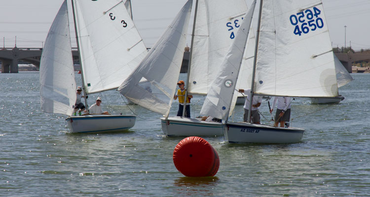 Trey Harlow approaches the leeward mark with inside position for the rounding. Photos: Mike Ferring
