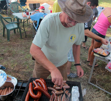 Steve Nahkala works the barbeque at Kinnikinick.
