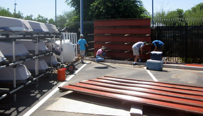 The work party builds storage units at Tempe Town Lake.