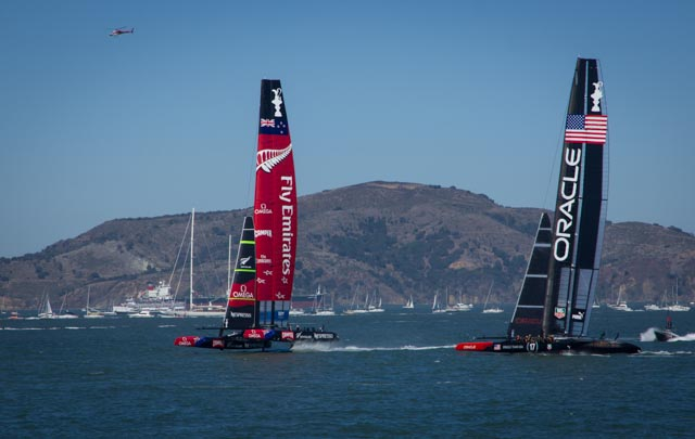 ETNZ and Oracle cross on the upwind leg of race one Saturday (9/7). Photos: Mike Ferring
