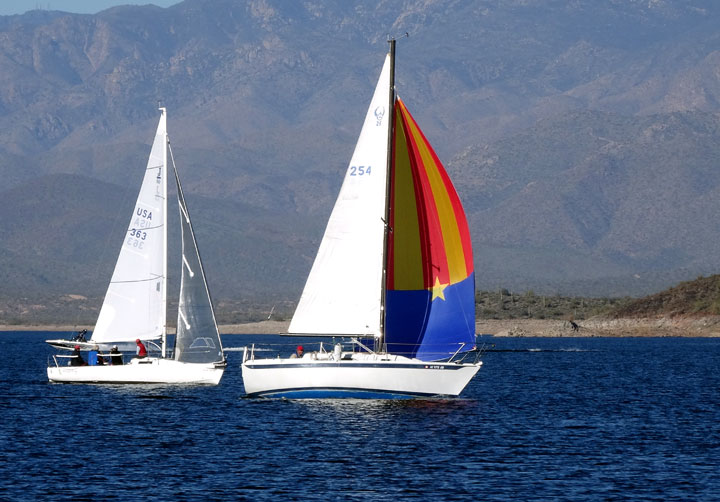 The Ferrings' J/80 and Tom Errickson's colorful Erickson 26 on New Year's Day. Photo: Janet Cohen