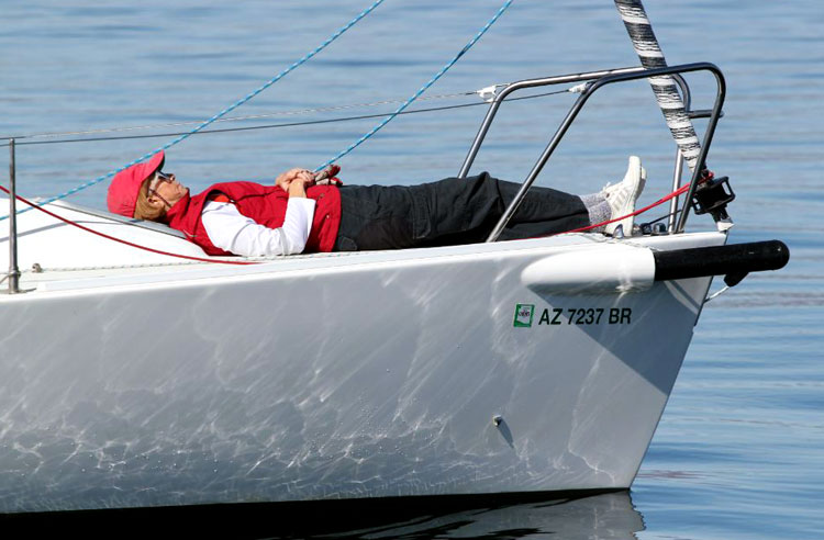 During a break in the action, Maryellen Ferring warms up on the bow of Melissa Kay. Photo: Victor Felice