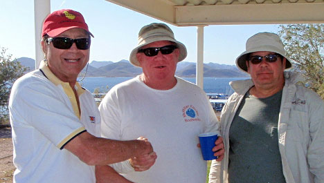 Cruising Captain and event organizer Ralph Vatalaro presents a prickly prize to Scott Battle (right) and crew Doug McMillan.