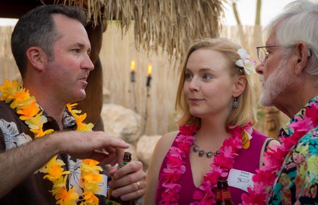 Trey Harlow explains mark rounding to Life Member Mike Yarnell. Nina Harlow doubts it.