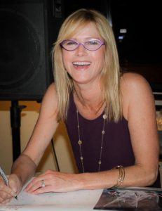 Sharon Green signed calendars and books for members at the November meeting.
