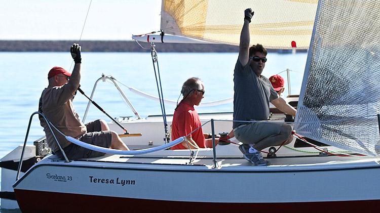 Teresa Lynn's crew cheers a good finish. Photo: Chris Smith