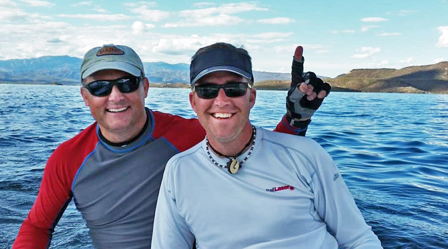 Laser champ Paul Miachika and crew Rob Gibbs signal their finishing spot: Club Champs. Photo: Victor Felice