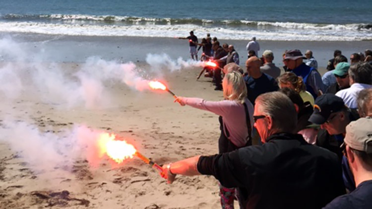The class tries out various flares on the beach in Santa Barbara. Photo: Art Vasenius